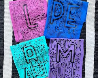 Library || PE || Music || Art || teacher shirts || educator shirt || grade level shirt
