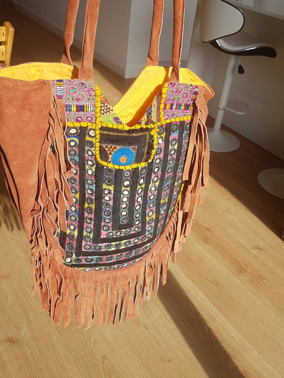 red suede bag with indian embroidery