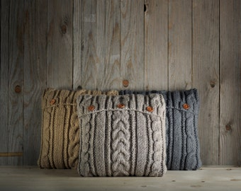Light gray-beige cable knit pillow cover with 3 wooden buttons.