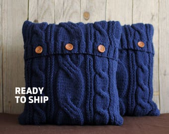 Ink blue color cable knit pillow cover with 3 wooden buttons. Ready to ship