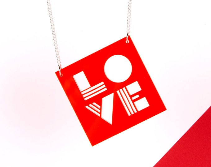 Unique neon red LOVE typographic statement necklace made from transparent acrylic