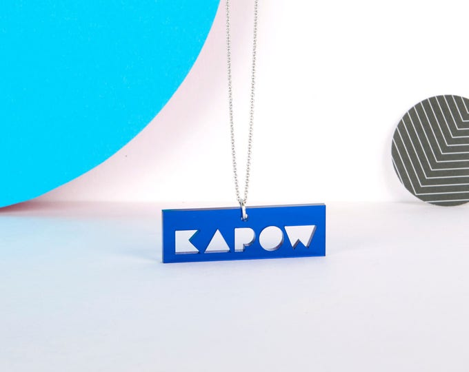 Blue transparent mini KAPOW typographic acrylic statement necklace