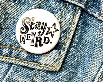 White Stay Weird hand drawn type badge
