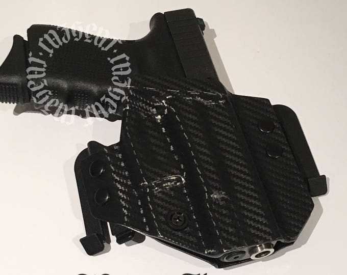 BlakJak Slim holster in Carbon Fiber (NEWMODEL!) . Click on variations when ordering.