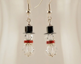 Clear Swarovski crystal snowmen with red crystal decorative scarves, silver accents, #0629