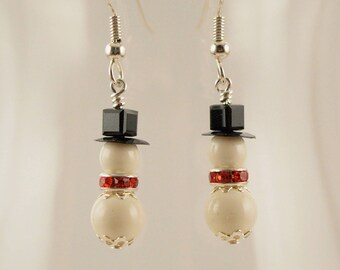 Swarovski crystal snowmen with red crystal floral scarves, silver accents, #0630