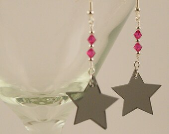 Smoky translucent stars with fuchsia Swarovski crystals and silver accents