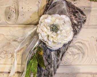 Silver faux fur stocking with white flower