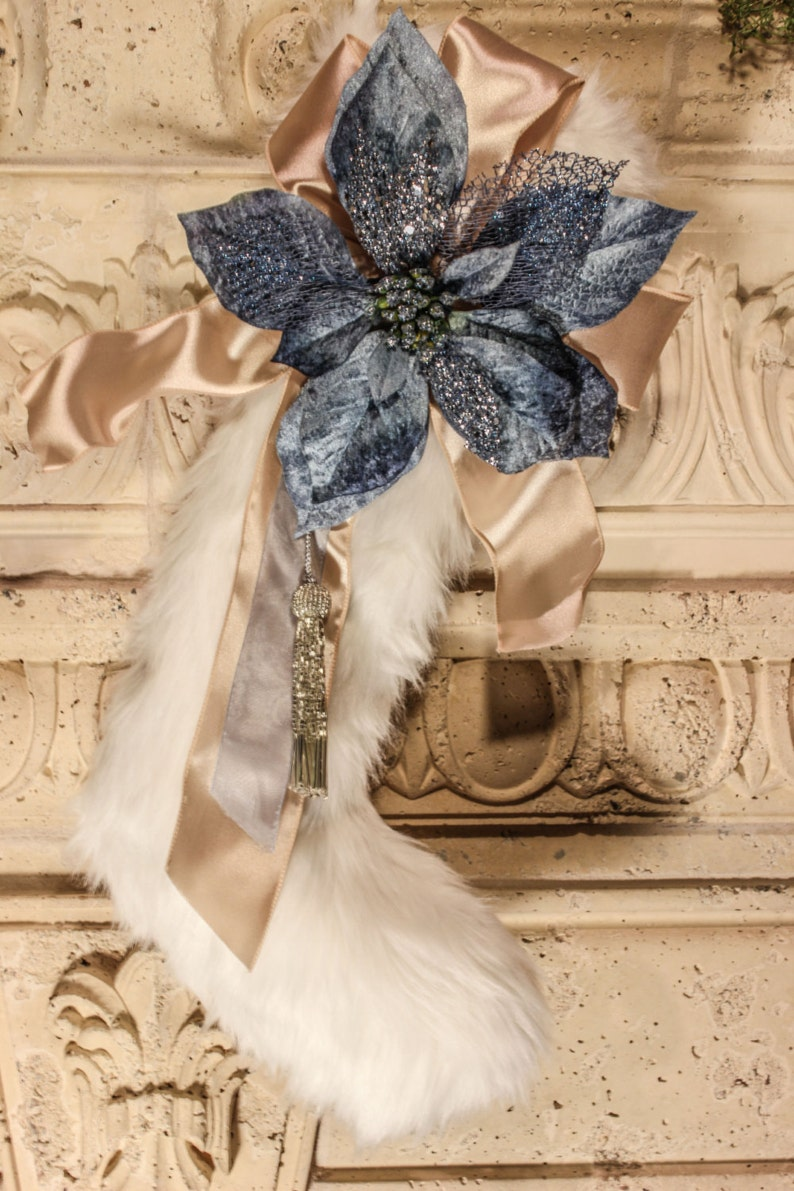 White faux fur stocking with blue flower