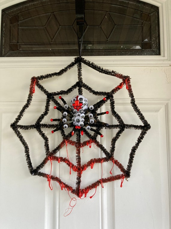 Tinsel Spider Web with bedazzled Tranchula and Googly Eyes