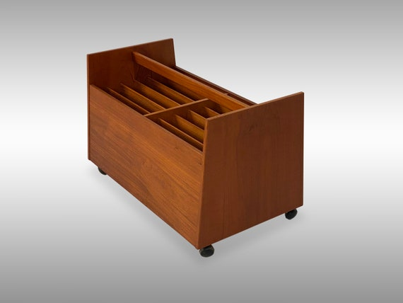 Teak Rolling Magazine Rack by Bruksbo of Norway, Circa 1970s - Please ask for a shipping quote before you buy.
