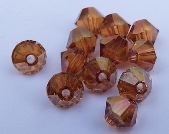 Close Out!  Crystal Copper Swarvoski Crystal, 4 mm, Bi-Cone, Pkg of 24, 5328 or 5301