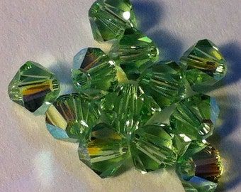Close Out! Peridot Green Swarvoski Crystal, AB, 4 mm Bi-cone, Pkg of 24,  5328 or 5301