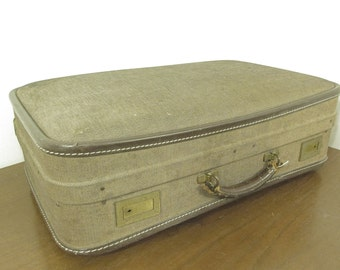Vintage cloth covered hard-sided suitcase
