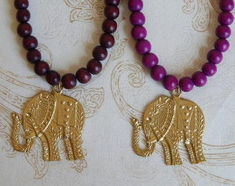 Gold elephant pendant necklace with purple wood beads, fall fashion jewelry, long layering necklace, handmade necklace, statement jewelry