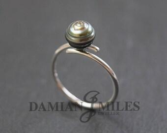 Tahitian Cultured Pearl Ring. Ringed Tahitian Cultured Pearl cross-over ring.