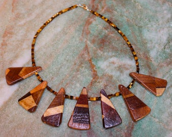 Hand Carved Triangle Multi Wood Art Necklace with Tigers Eye and Jasper By Jack Cousin