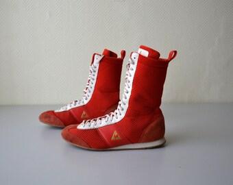 d2e5381201ef8 Paire de chaussures de boxe LE COQ SPORTIF   modele rouge et blanc    chaussures montantes basket vintage années 90   pointure 41