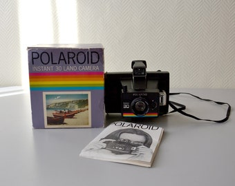 Vintage Polaroid INSTANT 30 in its original box with user manual.