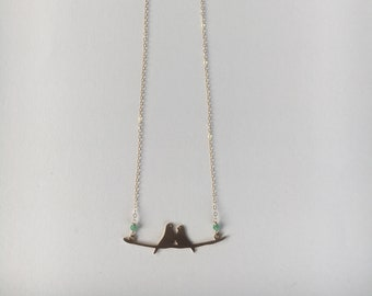 delicate gold necklace with gold-plated lovebirds pendant and chrysoprase accents