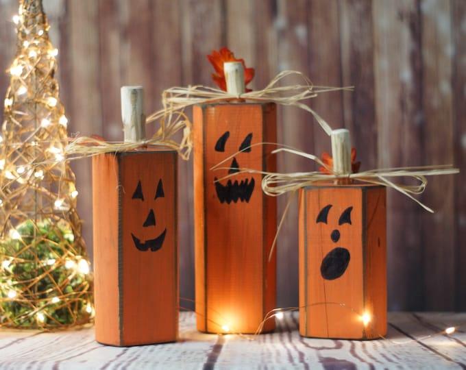 Featured listing image: Wood Pumpkins, Rustic Halloween Decor, Pumpkin Decor, Reclaimed Wood, Hand Painted Pumpkins, Primitive Halloween, Wooden Pumpkins, Fall