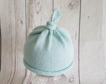 Coming home knitted baby beanie hat tieknot top roll brim bottom in aqua cotton yarn
