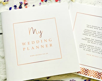 """The Ultimate Wedding Planner For Brides - 50 Page Wedding Organiser - And 1 FREE pair of """"TEAM BRIDE"""" Sunglasses!"""