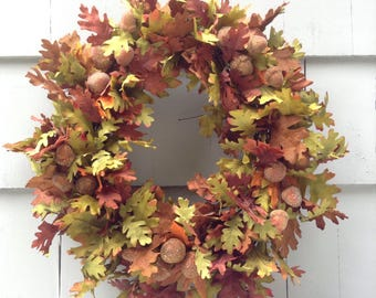 Autumn Beauty. Fall Foliage wreath in browns, rusts and greens. Masses of Faux Oak leaves and clusters of glittery acorns, grapevine base.