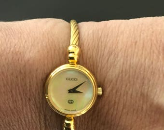 e94977e41fd Gucci lovely women s gold watch 100% authentic fits up to 6 1 2