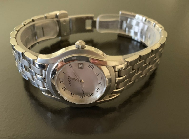 b9b22752582 Gucci beautiful 6 1 2 women s silver link watch 100%