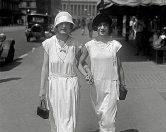 Walking Hand in Hand, 1924. Vintage Photo Reproduction Poster Print. Black & White Photograph. Flapper, Girls, Friends, Summer, City, 1920s.