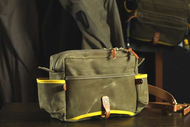 Brown Minimalist Waxed Canvas and Leather Fly Fishing Bag with Front Mounted Net Slot and Creel Style Strap