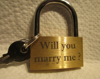 Marriage proposal with a love lock and personalized engraving