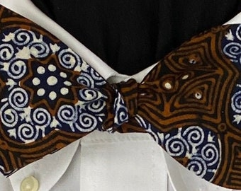 BATIK #3 : Indonesian Batik Cotton Bow Tie for the well-dressed, Vintage cotton with browns and black with a medallion of blue and white.