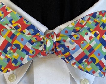 OFFSIDES! -  Liberty of London Cotton Bow Tie - for the well-dressed.  Referees take a stand in a small geometric print of primary colors.