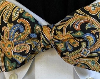 MIDNIGHT PAISLEY Bow Tie: Liberty of London fine cotton, for the well-dressed. Classic paisley in blues, greens and gold swirl on black
