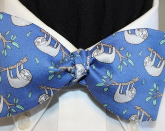 SLOTHS: Organic Cotton Sateen Bow Tie, adjustable Self Tie or 60s Clip On, sloths being sloths, hanging from branch, blue field