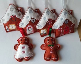 Homemade felt embroidered gingerbread houses christmas tree decoration made with love within the UK. Set of 4