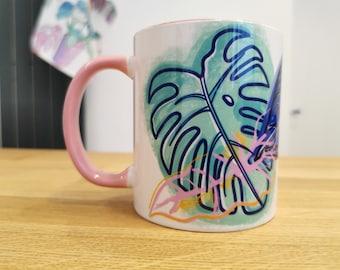 Pink monstera leaf botanical mug, turquoise leaf design, colourful kitchen accessories, botanical home design, monstera plant, new home mug