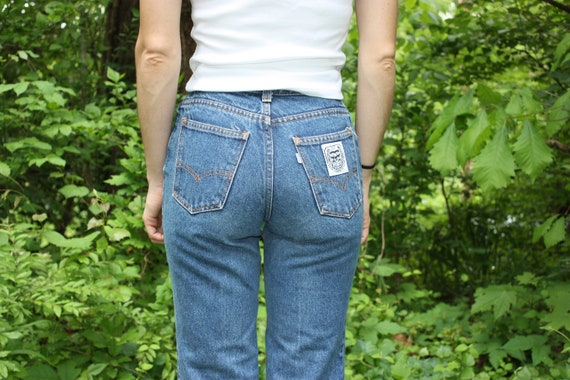 Levi Strauss and Co. Medium Wash Jeans. White Tab. 26 x 33.