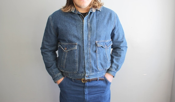 L-XL Vintage Lined Denim Levi's Coat.  Medium Wash Lined with Soft Flannel in Blue/Grey tones. 100% Cotton.