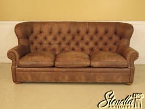 43061E: THOMASVILLE Tufted Distressed Leather Sofa w. Bun Feet
