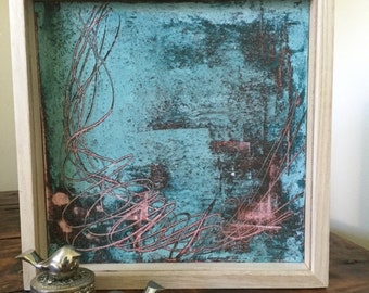 Cold encaustic wax layered art work in teal, pink and burnt umber