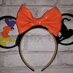 Hocus Pocus Ears - This magic headband includes the headband, 2 3D printed ears, and a Sequin bow. Hand painted Witch details and Black Cat