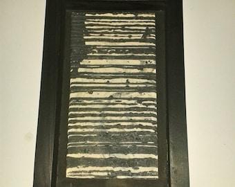 Black and white framed tile.