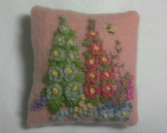 Pincushion hand embroidered with cottage flowers and bee