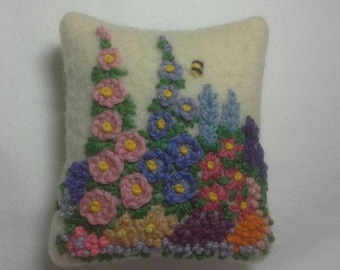 Hand embroidered pincushion with cottage garden flowers and bee