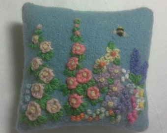 Pincushion hand embroidered with cottage flowers