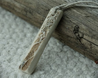Carved moose bone amulet