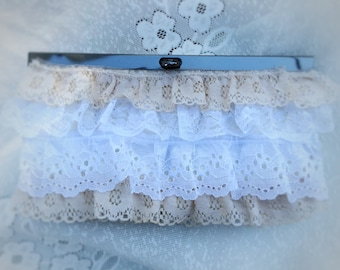 Upcycled vintage  clutch purse with floral interior and ruffled lace